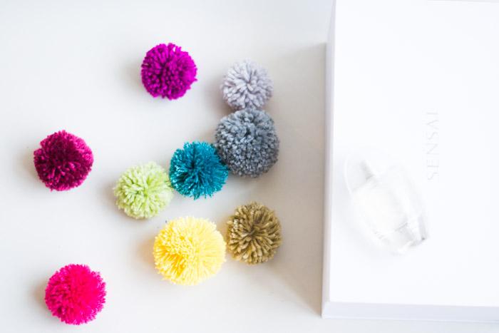 Decorar una caja con pompones